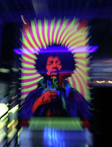 A Jimi Hendrix poster is on display at the Marquee club in London on Sept. 16, 2004.    AFP PHOTO / NICOLAS ASFOURI Photo: NICOLAS ASFOURI, Getty / 2010 AFP