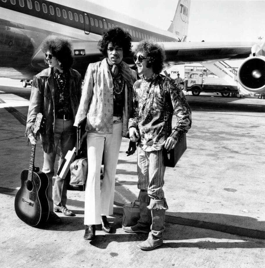 The Jimi Hendrix Experience at London Airport with their luggage Aug. 21, 1967. They are, from left to right; Noel Redding , bass player, Jimi Hendrix, singer, guitarist and  songwriter, and Mitch Mitchell, drummer. Photo: Express, Getty / Hulton Archive