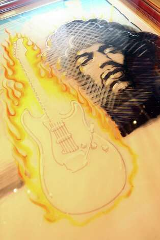 View of the poster showing Jimi Hendrix with flaming guitar, estimated between $20,000 and $30,000 from Peter Golding collection at Bonhams and Butterfields' office  in Hollywood  on April 17, 2008.    AFP PHOTO / VALERIE MACON Photo: VALERIE MACON, Getty / 2008 AFP