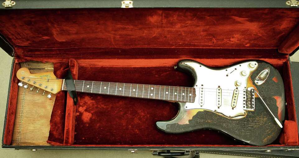 Jimi Hendrix's 1965 Fender Stratocaster guitar shows it's burn marks at the Idea Generation Gallery