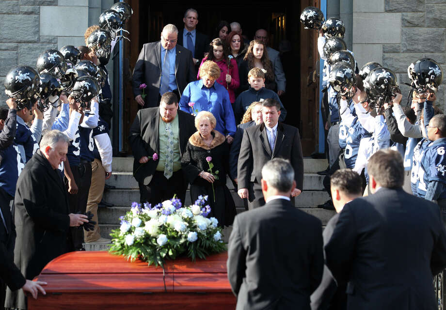 Denise Rowley Hunt and family leave Assumption Church after a funeral for her husband, former Ansonia High School football coach Jack Hunt in Ansonia, Conn. on Monday, November 26, 2012. Photo: BK Angeletti, B.K. Angeletti / Connecticut Post freelance B.K. Angeletti