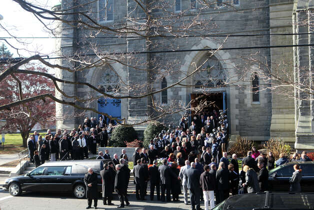 Mourners gather at Assumption Church after a funeral for former Ansonia High School football coach Jack Hunt in Ansonia, Conn. on Monday, November 26, 2012. Photo: BK Angeletti, B.K. Angeletti / Connecticut Post freelance B.K. Angeletti