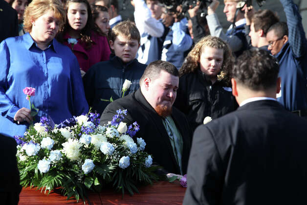 Family leaves Assumption Church after a funeral for former Ansonia High School football coach Jack Hunt in Ansonia, Conn. on Monday, November 26, 2012. Photo: BK Angeletti, B.K. Angeletti / Connecticut Post freelance B.K. Angeletti