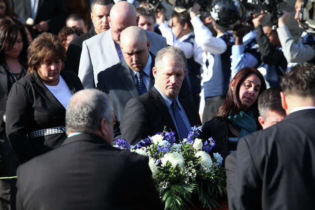 John J. Hunt III, center, and family leave Assumption Church after a funeral for his dad, former Ansonia High School football coach Jack Hunt in Ansonia, Conn. on Monday, November 26, 2012. Photo: BK Angeletti, B.K. Angeletti / Connecticut Post freelance B.K. Angeletti