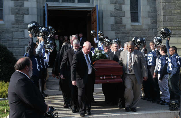 Pallbearers carry the casket of former Ansonia High School football coach Jack Hunt after a funeral mass at Assumption Church in Ansonia, Conn. on Monday, November 26, 2012. Photo: BK Angeletti, B.K. Angeletti / Connecticut Post freelance B.K. Angeletti