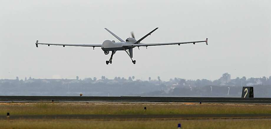 A Predator B drone lands at the Naval Air Station in Corpus Christi, Texas. Photo: Eric Gay, Associated Press
