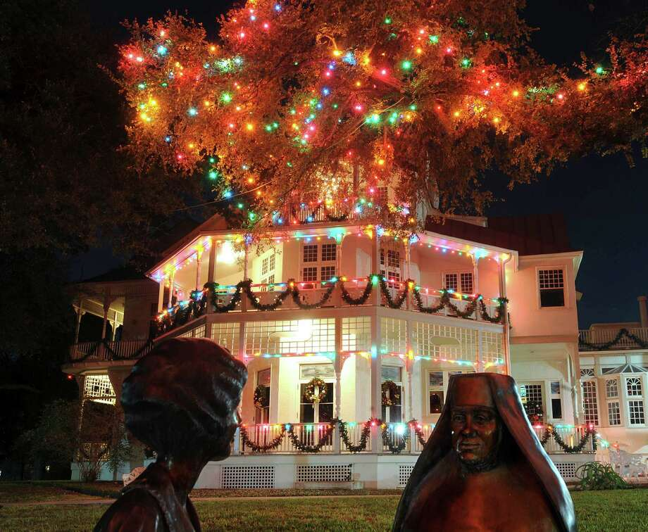 "The ""Living the CCVI Mission "" sculpture by artist Paul Tadlock and the George Washington Brackenridge Villa are illuminated by the ""Light the Way"" Christmas lights on the campus of the University of the Incarnate Word on Saturday, Nov. 24, 2012.  The lights were lit on November 17 and will shine through January 6, 2013. Photo: Billy Calzada, San Antonio Express-News / SAN ANTONIO EXPRESS-NEWS"