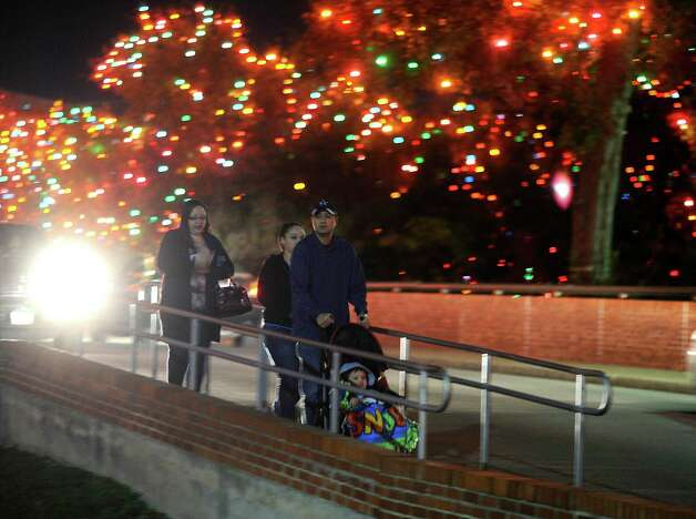 "People on foot and in cars tour the ""Light the Way"" Christmas lights on the campus of the University of the Incarnate Word on Saturday, Nov. 24, 2012. The display was lit on November 17 and will shine through January 6, 2013. Photo: Billy Calzada, San Antonio Express-News / SAN ANTONIO EXPRESS-NEWS"