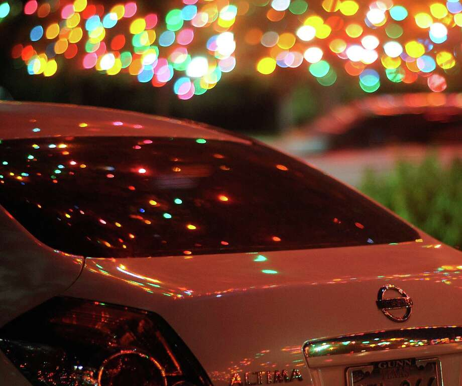 "The ""Light the Way"" Christmas lights on the campus of the University of the Incarnate Word are reflected off of cars on Saturday, Nov. 24, 2012. Photo: Billy Calzada, San Antonio Express-News / SAN ANTONIO EXPRESS-NEWS"