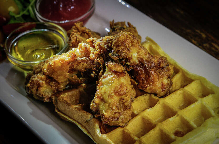 """The more creative offerings are reserved for the blackboard specials, which changed almost completely over the course of three visits ... On my last visit, the blackboard menu featured chicken drumettes ($14), perfectly fried and served with a thick, puffy waffle and a side of honey. They deserve a permanent place on the menu."" Photo: John Storey, Special To The Chronicle / John Storey"