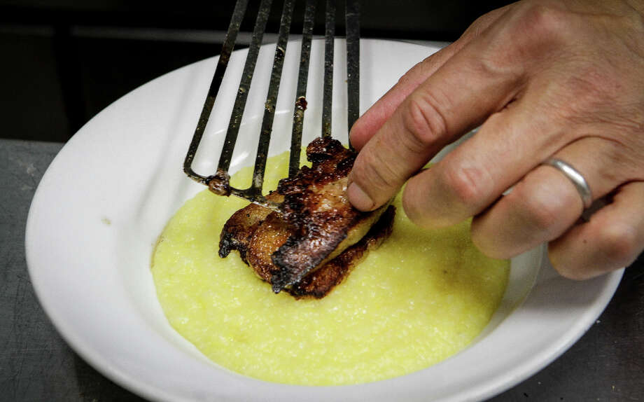 """However another dish, pork belly on polenta ($13), was less successful; the black pepper gastrique was too sweet and the meat had a warmed-over taste."" Photo: John Storey, Special To The Chronicle / John Storey"