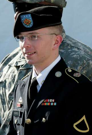FILE - In this June 25, 2012, file photo, Army Pfc. Bradley Manning is escorted out of a courthouse in Fort Meade, Md., after a pretrial hearing. Manning, the U.S. Army private charged with sending reams of government secrets to WikiLeaks, is expected to testify during a pretrial hearing starting Tuesday, Nov. 27, 2012, at Fort Meade. Manning is seeking dismissal of all charges. He claims his solitary confinement, sometimes with no clothing, was illegal punishment. (AP Photo/Patrick Semansky, File) Photo: Patrick Semansky