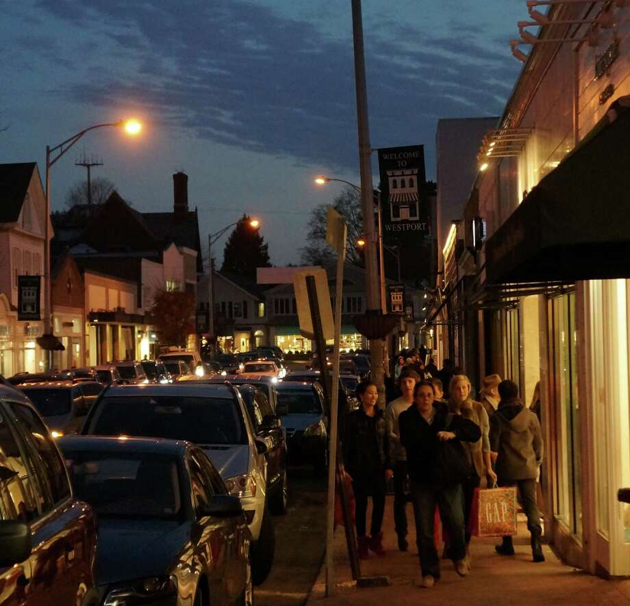 Shoppers flocked to Main Street in downtown Westport on Black Friday. Friday, Nov. 23, 2012/ Westport, CT Photo: Paul Schott / Westport News
