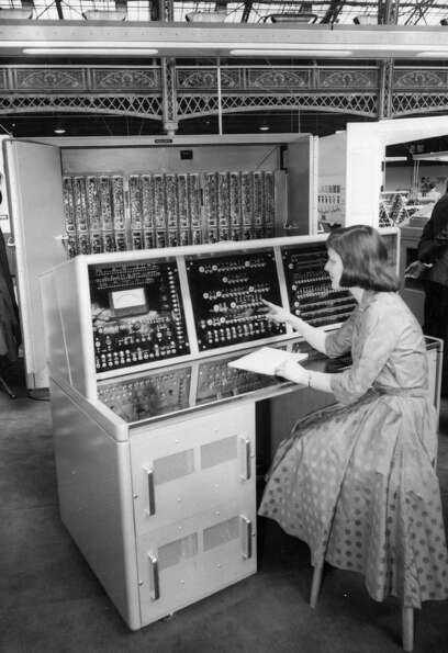 A woman tries out the Hollerith General Purpose Electronic Computer on May 12, 1958 at the Third Pro