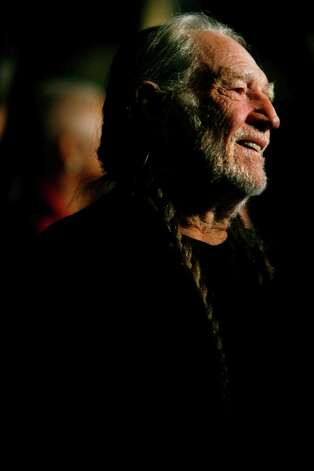 Singer Willie Nelson is seen on the red carpet of the Mark Twain Prize for American Humor, honoring Bill Cosby, in Washington, on Monday, Oct. 26, 2009. (AP Photo/Jacquelyn Martin) Photo: Jacquelyn Martin, STF / Beaumont