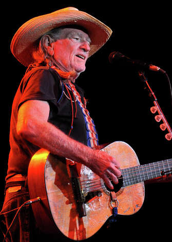 Willie Nelson performs at the Julie Rogers Theater in Beaumont, Wednesday. Tammy McKinley/The Enterprise Photo: TAMMY MCKINLEY