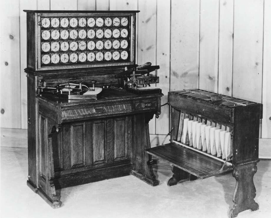 The Hollerith tabulator and sorter box, invented by Herman Hollerith and used in the 1890 United States census, is shown in this photo circa 1960. This precursor to modern digital computers 'read' cards by passing them through electrical contacts. Closed circuits, which indicated hole positions, could then be selected and counted. Hollerith's Tabulating Machine Company, founded in 1896, was a predecessor to International Business Machines (IBM). Photo: Hulton Archive, Getty Images / Hulton Archive