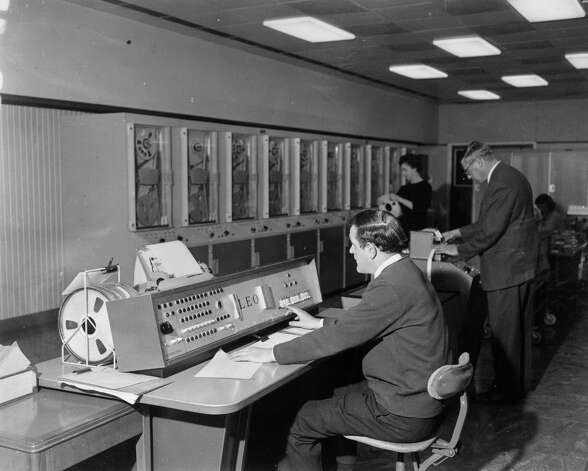 "A programmer uses English Electric's Leo III ""super computer"" to calculate trade figures for the U.K. Board of Trade on March 3, 1965. Photo: Woolcott, Getty Images / Hulton Archive"