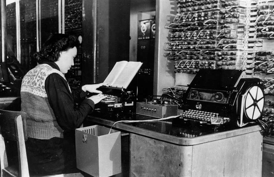 Technician Tamara Kondratyeva types English text on a perforator the  BESM computer, which translates English into Russian, on January 14, January 1956. Photo: Keystone, Getty Images / Hulton Archive