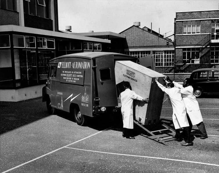 A National-Elliot 803 computer is loaded onto a customized Austin 32 cwt van on June 4, 1960 at the