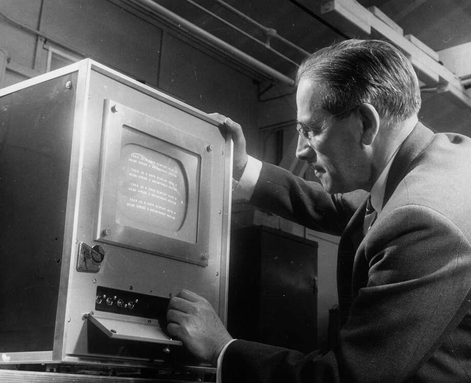 "Original May 1964 caption:  ""Dr A T Starr with the Matricon, which will display information at a speed to match the fastest computer."" Photo: Keystone, Getty Images / Hulton Archive"