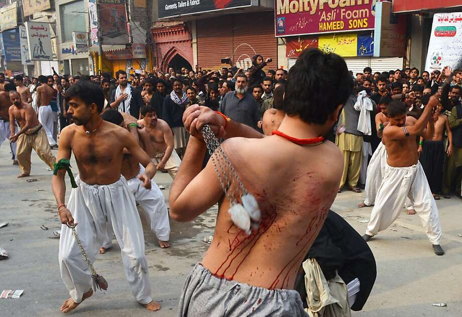 Sunday, bloody Sunday:In Peshawar, Pakistan, Shiites whip themselves with blades on chains to mark Sunday's anniversary of Islamic saint Imam Hussain's death in 680. Photo: A. Majeed, AFP/Getty Images