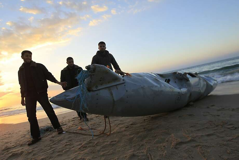 Look what we 'shot down':Hamas security forces inspect what appears to be part of an aircraft that washed ashore near Rafah in the Gaza Strip. Hamas media outlets claimed it was part of an Israeli plane brought down by militants, but there were no identifying marks on the wreckage that could corroborate the story. Photo: Said Khatib, AFP/Getty Images