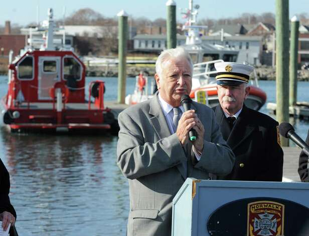 Mayor Richard Moccia with Fire Chief Denis McCarthy at the Norwalk Fire Department ceremony commissioning their new Fire Boat Marine Unit 238 at Veterans Memorial Park on Monday, Nov. 26, 2012 in Norwalk, Conn. The vessel was named the Robert Bedell in honor of firefighter Bedell who served the Department with distinction from 1975 until his untimely death in 2004. Photo: Cathy Zuraw / Connecticut Post