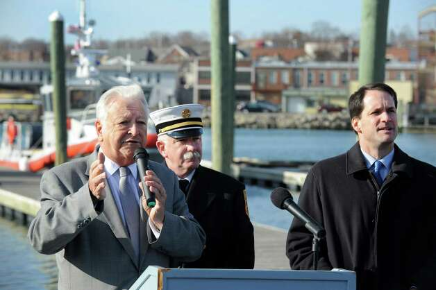 Mayor Richard Moccia with Fire Chief Denis McCarthy, Congressman Jim Himes at the Norwalk Fire Department ceremony commissioning their new Fire Boat Marine Unit 238 at Veterans Memorial Park on Monday, Nov. 26, 2012 in Norwalk, Conn. The vessel was named the Robert Bedell in honor of firefighter Bedell who served the Department with distinction from 1975 until his untimely death in 2004. Photo: Cathy Zuraw / Connecticut Post