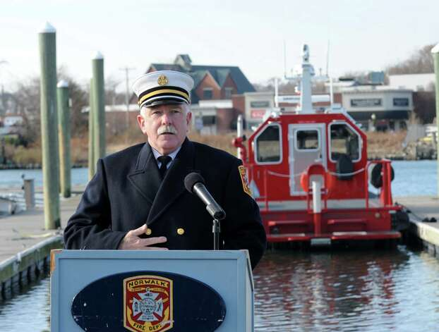 Norwalk Fire Chief Denis McCarthy opens the ceremony commissioning the department's new Fire Boat Marine Unit 238 at Veterans Memorial Park on Monday, Nov. 26, 2012 in Norwalk, Conn. The vessel was named the Robert Bedell in honor of firefighter Bedell who served the Department with distinction from 1975 until his untimely death in 2004. Photo: Cathy Zuraw / Connecticut Post