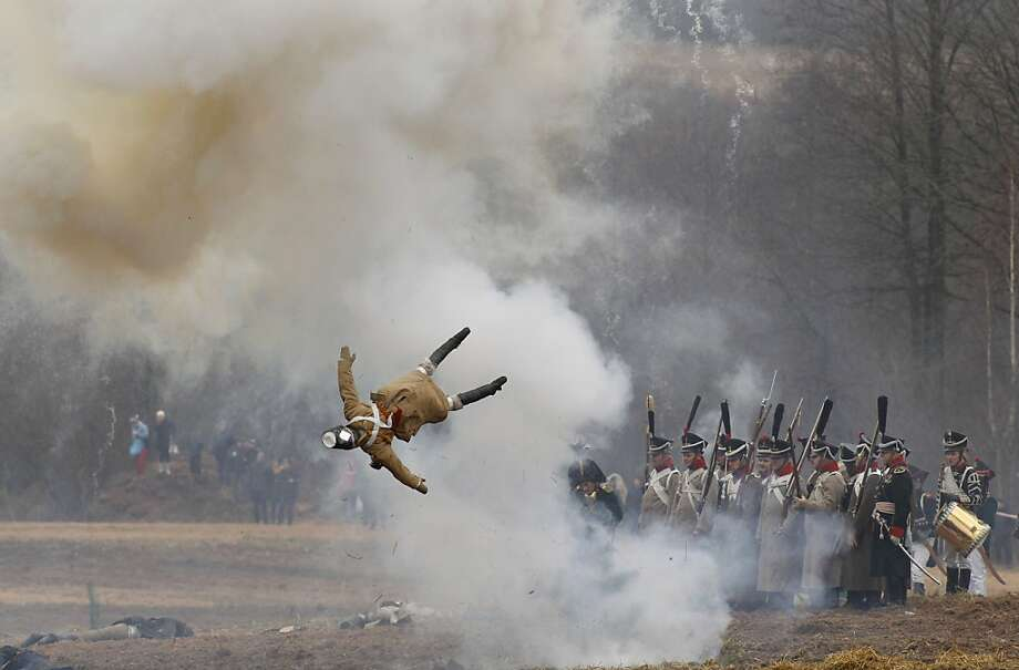 And that was the end of poor Yuri:War buffs dressed as 1812-era Russian and French soldiers re-enact the battle of Berezina on its 200th anniversary near the Belarus village of Bryli. Berezina was fought Nov. 26 to Nov. 29, 1812, as the remnants of Napolean's once great army retreated from Russia. Some 50,000 people, soldiers from both sides and civilians, were killed. The soldier being blown up here is actually a dummy. Photo: Sergei Grits, Associated Press