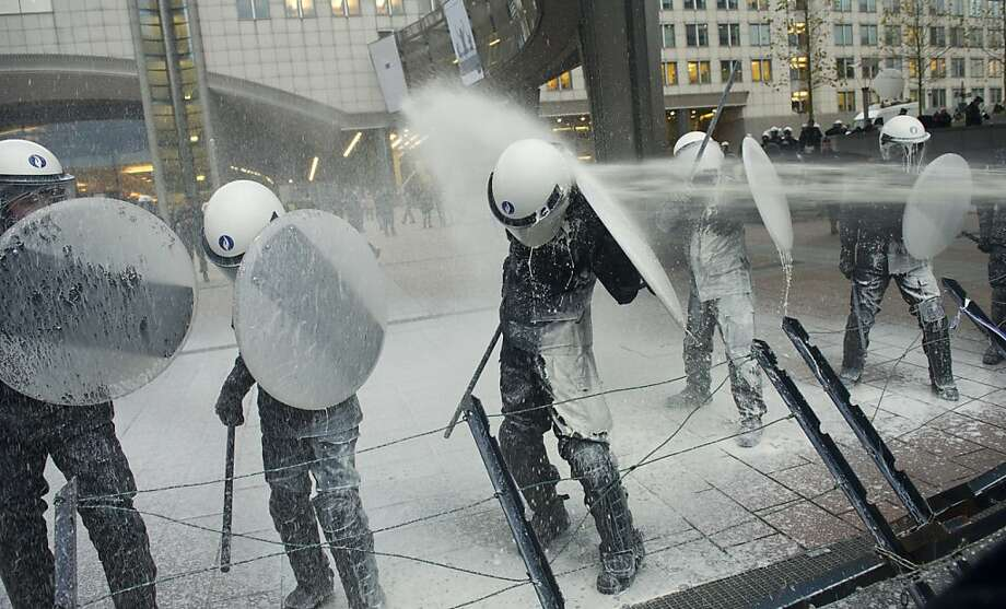Brussels spout:Farmers hose down riot cops with milk during a protest outside the European Parliament in Brussels. The dairymen were demonstrating against what they believe are unfair milk prices. Photo: Geert Vanden Wijngaert, Associated Press