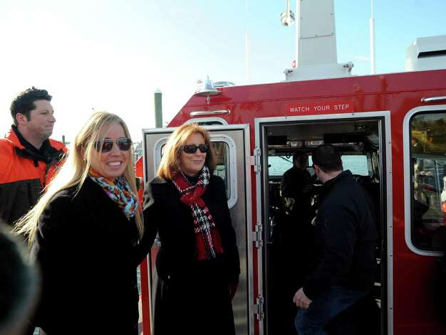 Common Council Member Michelle Maggio and Linda Bedell, wife of Firefighter Robert Bedell stand on the deck of the new Fire Boat Marine Unit 238 at Veterans Memorial Park on Monday, Nov. 26, 2012 in Norwalk, Conn. The vessel was named the Robert Bedell in honor of firefighter Bedell who served the Department with distinction from 1975 until his untimely death in 2004. Photo: Cathy Zuraw / Connecticut Post