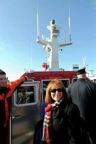 Linda Bedell, wife of Firefighter Robert Bedell stands on the deck of the new Fire Boat Marine Unit 238 at Veterans Memorial Park on Monday, Nov. 26, 2012 in Norwalk, Conn. The vessel was named the Robert Bedell in honor of firefighter Bedell who served the Department with distinction from 1975 until his untimely death in 2004. Photo: Cathy Zuraw / Connecticut Post