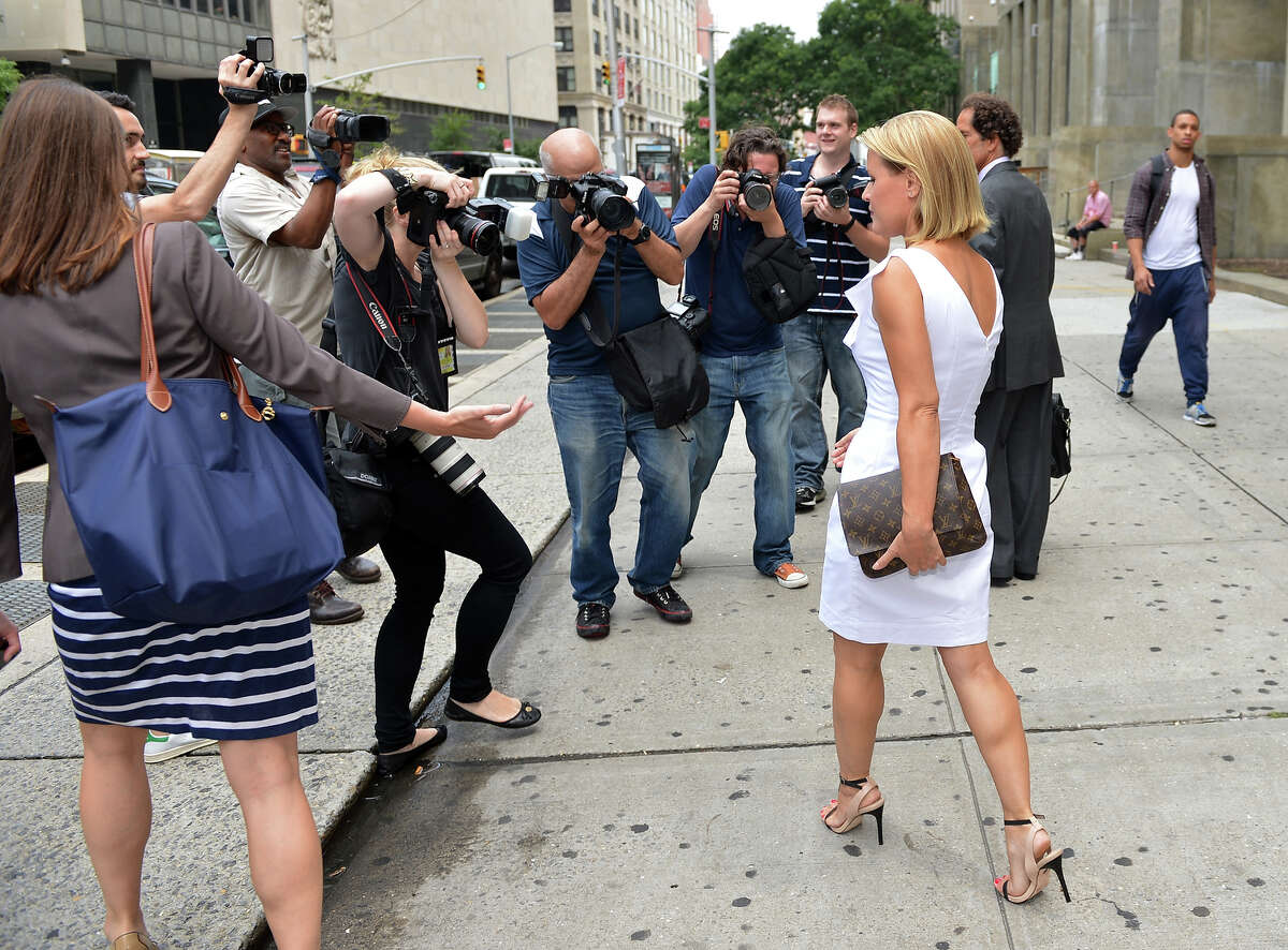 Canadian actress Genevieve Sabourin (R) leaves July 26, 2012 from Manhattan Criminal Court in New York. The 40-year-old actress, who is accused of stalking actor Alec Baldwin, faces five charges including two counts of harassment in the second degree and stalking. AFP PHOTO/Stan HONDA (Photo credit should read STAN HONDA/AFP/GettyImages)