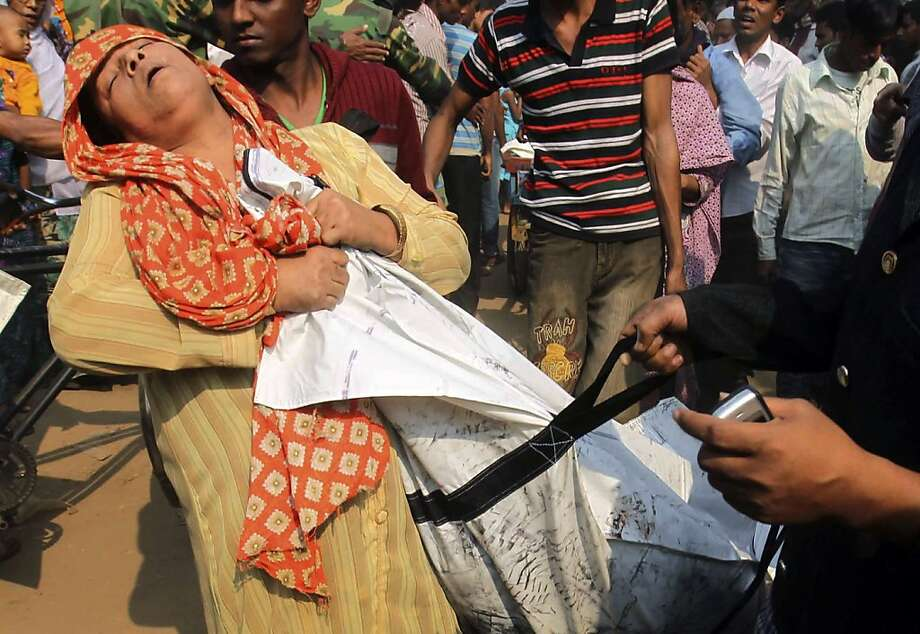The horror of recognition: A Bangladeshi woman nearly passes out as she claims the body of a relative killed in a fire at a garment factory outside Dhaka. At least 112 people perished in the blaze. Photo: Jibon Amir, Associated Press