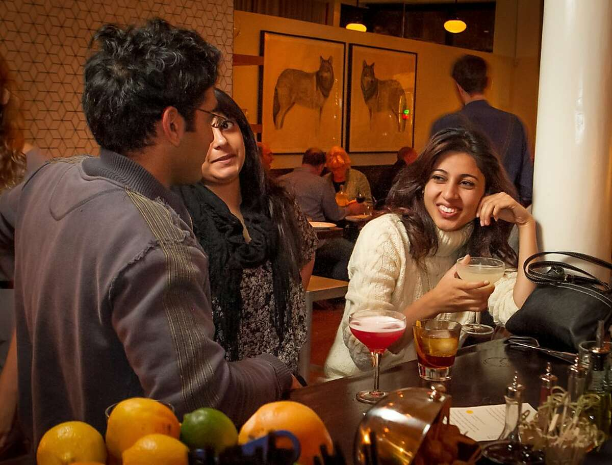 (Right to Left) Anisha Babbar, Pramiti Singh, and Sameer Singh enjoy drinks at Locanda in San Francisco, Calif., on Friday, November 23rd, 2012.