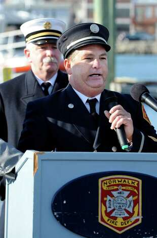 Lt Tim Morrissette speaks at the Norwalk Fire Department ceremony commissioning their new Fire Boat Marine Unit 238 at Veterans Memorial Park on Monday, Nov. 26, 2012 in Norwalk, Conn. The vessel was named the Robert Bedell in honor of firefighter Bedell who served the Department with distinction from 1975 until his untimely death in 2004. Photo: Cathy Zuraw / Connecticut Post
