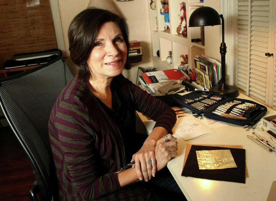 Thelma Muraida is an artist, graphic designer and book illustrator whose work will be featured at this year's Hecho A Mano, the Guadalupe Cultural Arts Center's holiday market. Photo: Helen L. Montoya, San Antonio Express-News / ©SAN ANTONIO EXPRESS-NEWS