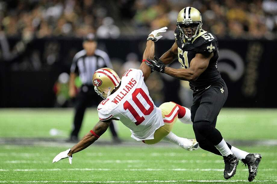 NEW ORLEANS, LA - NOVEMBER 25:  Kyle Williams #10 of the San Francisco 49ers is knocked down by Jonathan Vilma #51 of the New Orleans Saints during a game at the Mercedes-Benz Superdome on November 25, 2012 in New Orleans, Louisiana. Photo: Stacy Revere, Getty Images / 2012 Getty Images