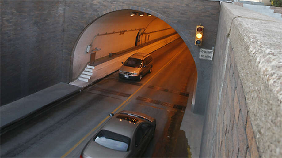 Cars cross the Washburn Tunnel in Houston during a regular traffic day on Wednesday, Jan. 28, 2009, in Houston. The tunnel is a two-lane underwater motor-vehicle tunnel connecting Galena Park and Pasadena, two suburbs of Houston, Texas. Completed in 1950, it travels north-south underneath the Houston Ship Channel. It was named after Harris County, Texas Auditor Harry L. Washburn. Photo: Julio Cortez, . / Houston Chronicle