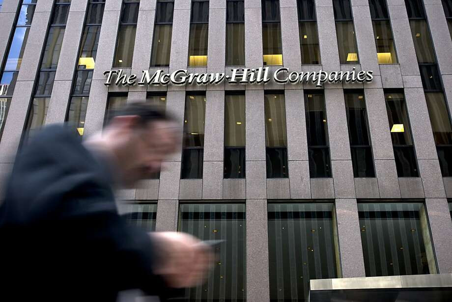A pedestrian walks in front of the McGraw-Hill Cos. headquarters in New York, U.S., on Wednesday, Aug. 24, 2011. McGraw-Hill Cos., which does everything from selling textbooks to rating government bonds and compiling car surveys, may be worth at least 40percent more if sold and broken into pieces. Photographer: Scott Eells/Bloomberg Photo: Scott Eells, Bloomberg