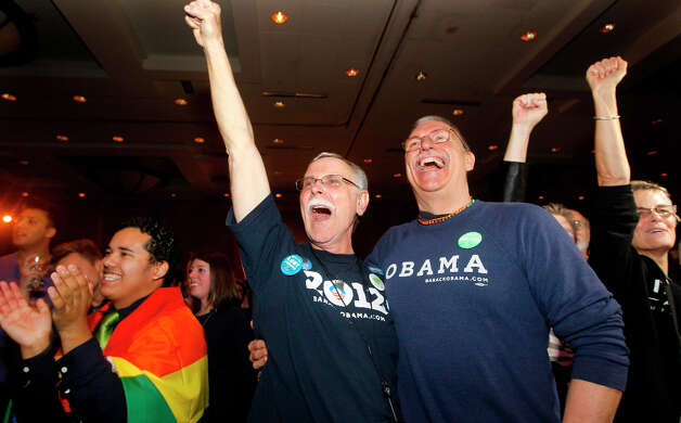 Rick Sturgiol, right, and his partner of 34 years Jim Malatak cheer at an election watch party for proponents of Referendum 74, Tuesday, Nov. 6, 2012, in Seattle. (AP Photo/Elaine Thompson) Photo: Elaine Thompson, AP / AP