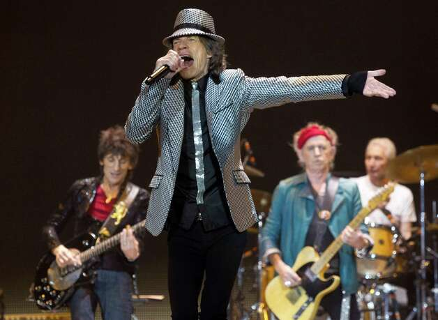 Mick Jagger, front center, Ronnie Wood, left, with Keith Richards and Charlie Watts, right, of The Rolling Stones, perform at the O2 arena in east London, Sunday, Nov. 25, 2012. The band are playing five gigs to celebrate their 50th anniversary, including two shows at London's O2 and three more in New York. (Photo by Joel Ryan/Invision/AP) Photo: Joel Ryan