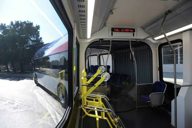 A new articulated bus makes a turn as its driver trains on Nov. 20, 2012. VIA Metropolitan Transit will launch its new bus rapid transit service, VIA Primo, soon. The service will consist of 60 feet, articulated buses, compared to the 40 feet buses on most VIA routes. The bike rack in foreground holds three bicycles. Photo: Billy Calzada, San Antonio Express-News / SAN ANTONIO EXPRESS-NEWS