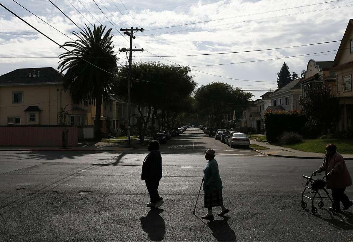 The South Berkeley Senior Center walking group strolls around the block on Thursday, November 15, 2012 in Berkeley, Calif.