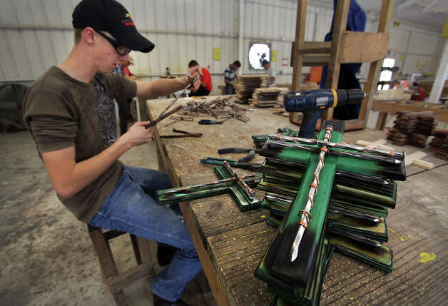 Shane Fredrickson, a member of Teen Challenge, assembles crosses from donated scrap wood and other materials. The crosses are sold to support programs that help adults with drug and alcohol abuse problems change their lifestyles through long-term residential recovery centers. Photo: Bob Owen, San Antonio Express-News / © 2012 San Antonio Express-News