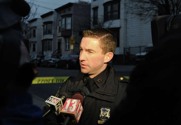 Albany police officer Steven Smith talks to the press at the scene at 157 Myrtle Ave. (house just left of officer's face) where he confirmed one person is dead and two others were injured after an attack at 2:30 pm on Monday, Nov. 26, 2012 in Albany, N.Y.  (Lori Van Buren / Times Union) Photo: Lori Van Buren