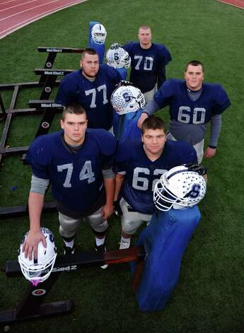 Staples offensive line during boys football practice in Westport, Conn. on Tuesday November 20, 2012. In back row: #70 Kyle Vaugn (RT), middle row left to right: #77 Nick Ward (LT), #60 Will Patrick (RG), front row left to right: #74 Chris Speer (Center) and #62 Burim Trdevaj (LG). Photo: Christian Abraham / Connecticut Post