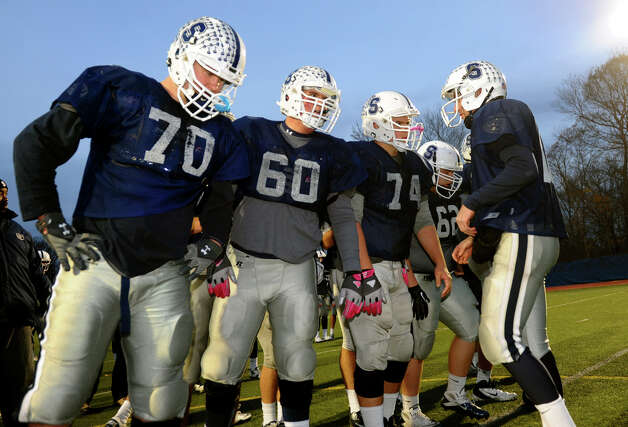 Staples offensive linemen #70 Kyle Vaughn, #60 Will Patrick, #74 Chris Speer and #62 Burim Trdevaj in the huddle during boys football practice in Westport, Conn. on Tuesday November 20, 2012. Photo: Christian Abraham / Connecticut Post